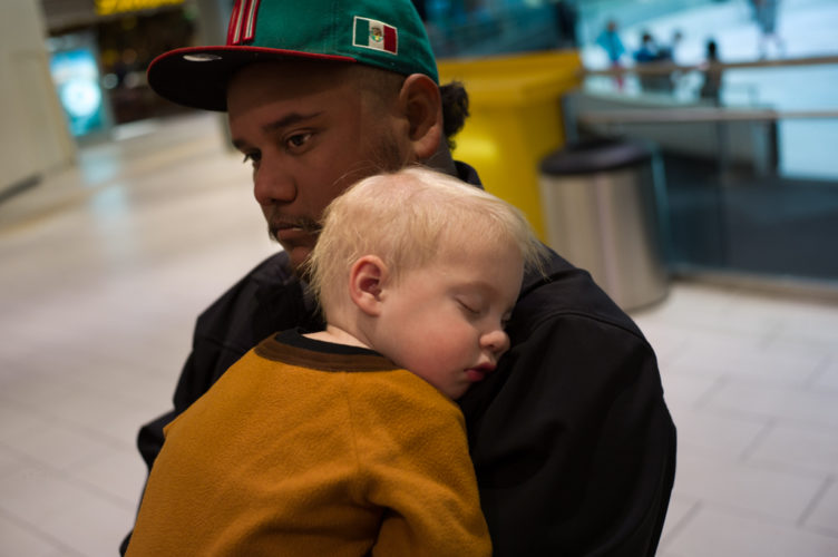 http://www.galleriadallas.com ; dallas texas mall galleria , a young mexican taking care of his son